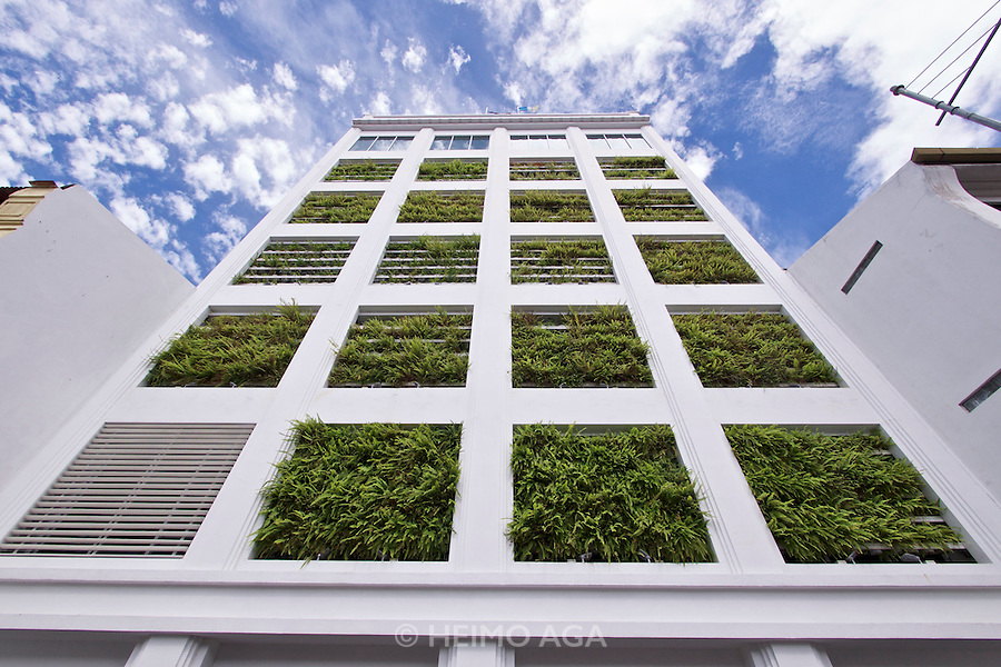 Malaysia, Penang. George Town. House with plants in facade.