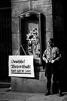 On April 1st, 1933, the boycott which was announced by the Nationalsocialistic party began.  Placard reads, &quot;Germans, defend yourselves, do not buy from Jews,&quot; at the Jewish Tietz store.  Berlin.  New York Times Paris Bureau Collection.  (USIA)<br /> Exact Date Shot Unknown<br /> NARA FILE #:  306-NT-178018<br /> WAR &amp; CONFLICT BOOK #:  985