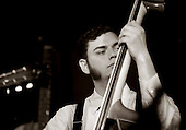 Joey Glynn, bass and vocals.  American group, Pokey LaFarge and the South City Three, play riverboat soul at the Blue Coconut Club, Pulborough, Sussex.