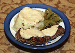 Country fried steak with green beans, mashed potatoes and country gravey . ©2015. Jim Bryant Photo. All Rights Reserved.