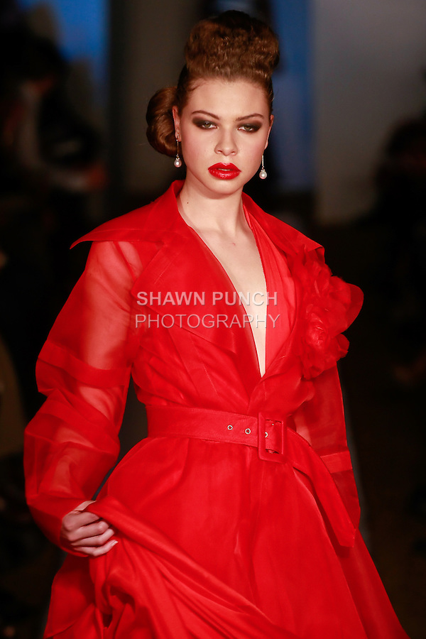 Model walks runway in an outfit from the Lucio Vanni Couture Fall 2012 collection, by Vanni Wang, during Plitzs Fashion Week New York Fall 2012.