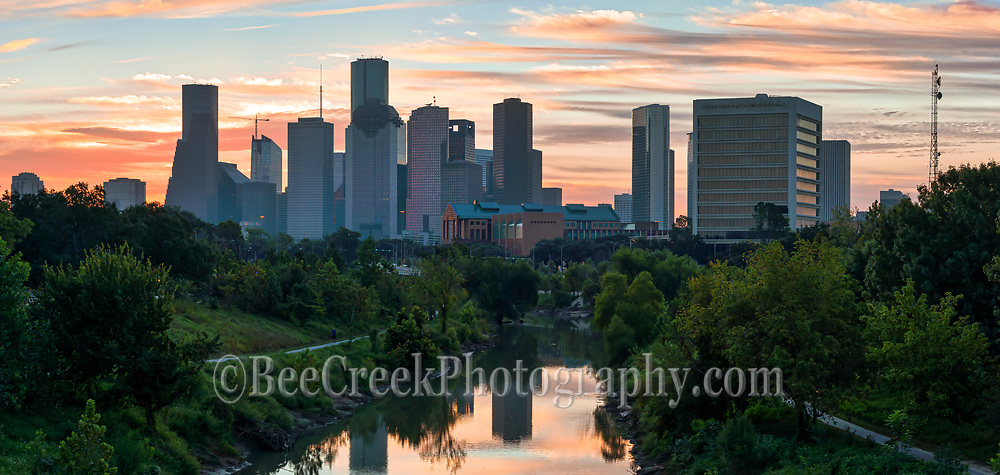 This is a pano of the Houston skyline at sunrise over the Buffalo Bayou in downtown area. Before the sun rise came up and we had some nice colors behind the city that reflected on water of the bayou below which gave a nice colorful look with these oranges and pinks,