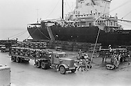 June 1972, Guam --- The Andersen Air Force Base on Guam Island from where the B-52 Stratofortress planes take off for Vietnam. A boat unloads bombs which are carried by truck to Andersen Base. --- Image by © JP Laffont/Sygma/Corbis