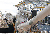 In Earth Orbit - May 15, 2009 -- While standing on the end of Atlantis' remote manipulator system arm, astronaut Michael Good, STS-125 mission specialist, works on the Hubble Space Telescope. Astronauts Good and Mike Massimino (out of frame), mission specialist, continue work on the Hubble Space Telescope, locked down in the orbiter's cargo bay. After their May 15 tasks were completed, three more sessions of extravehicular activity, on back to back to back days, awaited the seven-person crew..Credit: NASA via CNP