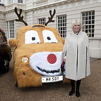 Children help Camilla decorate Clarence House Christmas tree - London