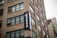 A sign announces the location of a a WeWork co-working space location in New York on Sunday, January 22, 2017. WeWork is reported to preparing for an initial public offering.  (© Richard B. Levine)