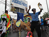 2/15/09--A man dressed up like a police officer depicting police brutality dances during the carnival in the southern town of Arroyo in Puerto Rico..Photo by Angel Valentin, copyright 2009. NO MODEL RELEASE.