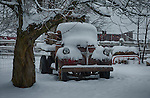 A vintage truck covered in snow on a farm in Hayden, Idaho.