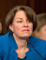 United States Senator Amy Klobuchar (Democrat of Minnesota) listens as Judge Neil Gorsuch testifies before the committee on his nomination as Associate Justice of the US Supreme Court to replace the late Justice Antonin Scalia on Capitol Hill in Washington, DC on Tuesday, March 21, 2017.<br /> Credit: Ron Sachs / CNP /MediaPunch