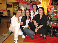September 13, 2009; Mie, Japan;  Ukrainian delegation members (L-R) Nataliya Yeromina (judge), Anna Bessonova, Viktoria Bessonova, Irina Deriugina pose for portrait at banquet after 2009 World Championships Mie. Photo by Tom Theobald. .