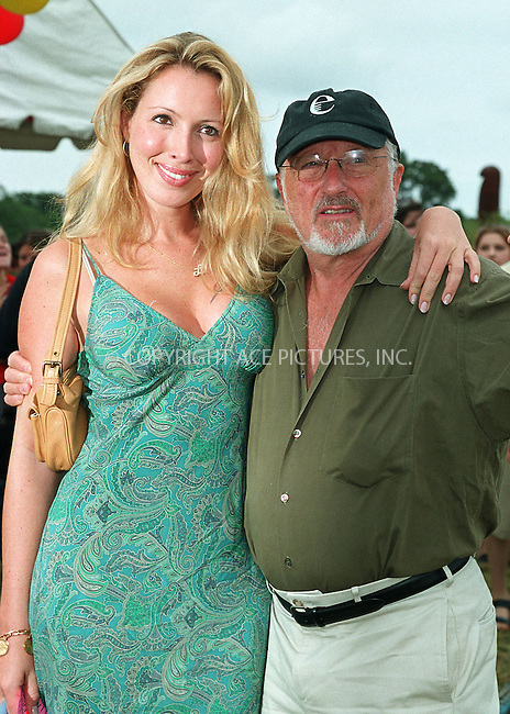 """Lulu Johnson (daughter of Betsey Johnson) and Stan Herman at the Fifth Annual """"Super Saturday"""" designer sale and family event to benefit the ovarian cancer research fund. Water Mill, Long Island. July 27, 2002. Please byline: Alecsey Boldeskul/NY Photo Press.   ..*PAY-PER-USE*      ....NY Photo Press:  ..phone (646) 267-6913;   ..e-mail: info@nyphotopress.com"""