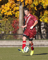Boston College defender Matt Wendelken (8) passes the ball. Boston College (maroon) defeated Virginia Tech (Virginia Polytechnic Institute and State University) (white), 3-1, at Newton Campus Field, on November 3, 2013.