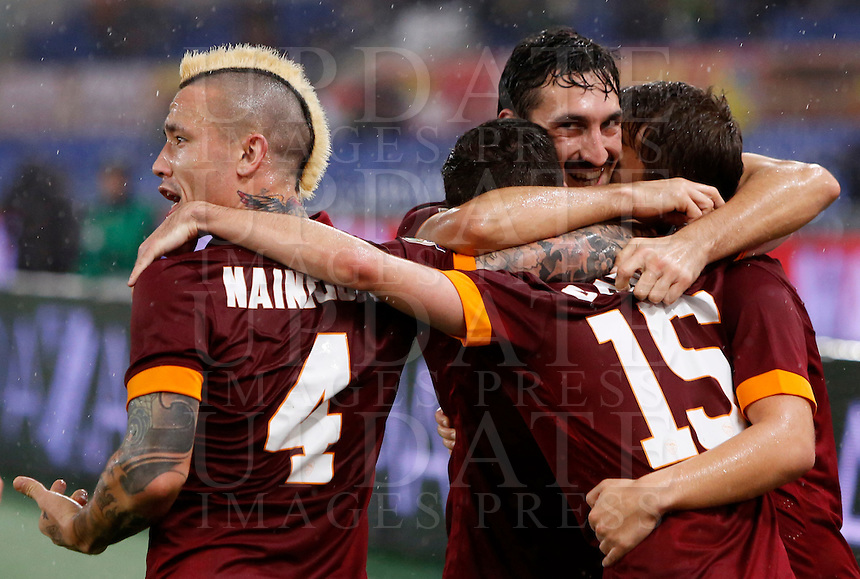 Calcio, Serie A: Roma vs Inter. Roma, stadio Olimpico, 30 novembre 2014.<br /> Roma&rsquo;s Miralem Pjanic, second from left, back to camera, celebrates with teammates after scoring during the Italian Serie A football match between AS Roma and FC Inter at Rome's Olympic stadium, 30 November 2014.<br /> UPDATE IMAGES PRESS/Riccardo De Luca