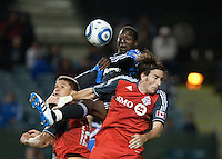Ike Opara (center) goes up for the ball between Adrian Cann (left) and Alan Gordon (right). The San Jose Earthquakes tied Toronto FC 1-1 at Buck Shaw Stadium in Santa Clara, California on April 9th, 2011.