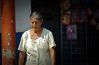 This series of photographs capture the scenic and peaceful rural town of Cuichapa located in the municipal of Veracruz, Mexico. I wanted to capture the unique rich culture that the locals experience, which many tourists stray away from, yet I think its simple and inner beauty can be easily absorbed with wonderful raw and organic illustrations.<br /> <br /> These photographs illustrate the picturesque of the unique colors, architecture, and traditions that embody Mexican culture. The men and women setting up shops along the towns center grounds selling their own farm goods of fruit, vegetables, raw sugar cane, and cold cuts that you see hanging on nearby open market windows.