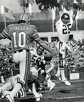 Oakland Invader punter Stan Talley has his punt blocked by Denver Gold #25 Darryl Hemphill and Tom Kilkenny.(1985 photo/Ron Riesterer)