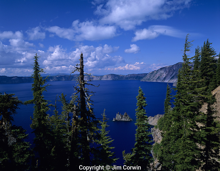 Crater Lake National Park Klamath County Phantom Ship protruding up through deep blue water of Crater Lake Central Oregon State USA