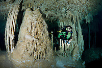 RX0913-D. scuba diver (model released) explores a freshwater filled cavern accessible via a cenote (a sinkhole) in the jungle. This underground chamber is decorated with beautiful stalactites, stalagmites and columns, delicate limestone formations created over millions of years. Riviera Maya, Yucatan Peninsula, Mexico.<br /> Photo Copyright &copy; Brandon Cole. All rights reserved worldwide.  www.brandoncole.com