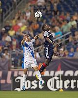 Puebla FC midfielder Jose Gonzalez (7) and New England Revolution midfielder Joseph Niouky (23) battle for head ball. The New England Revolution defeated Puebla FC in penalty kicks, in SuperLiga 2010 semifinal at Gillette Stadium on August 4, 2010.