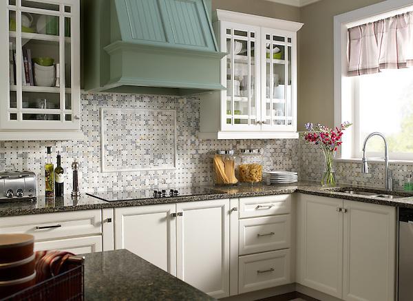This custom kitchen features a handmade Basketweave mosaic backsplash shown  in Calacatta Tia Baroque and tumbled
