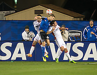 Santa Clara, California -Saturday, March 29, 2014: Clarence Goodson of SJ Earthquakes jump for the ball during a match against NE Revolution at Buck Shaw Stadium. Final Score: SJ Earthquakes 1, NE Revolution 2
