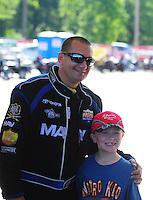 May 6, 2012; Commerce, GA, USA: NHRA top fuel dragster driver Brandon Bernstein poses with a young fan during the Southern Nationals at Atlanta Dragway. Mandatory Credit: Mark J. Rebilas-