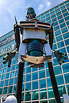 Garden City, New York, USA. 14th June 2015. The tall robot man metal sculpture, by artist C. Evan Gray, is on display outdoors in front of the glass facade of the Cradle of Aviation Museum, at Eternal Con, the Long Island Comic Con. The sculptor created it from automotive and other parts.