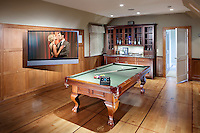 This area of the house is where you can play pool, watch a great movie in a theater-like setting or have a cocktail. Press a button and Control4 makes it happen!