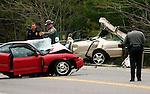 NEW HARTFORD, CT - 22 APRIL 2005 - 042205JS01--Connecticut State police investigate a two-car fatal accident on Route 202 in New Hartford on Friday afternoon. The accident, near the Nepaug Reservoir, had the road closed for most of the afternoon. <br /> --Jim Shannon Photo --New Hartford, Route 202, Nepaug Reservoir are CQ