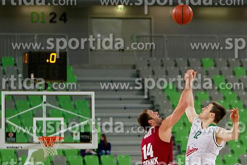 Bader Marton #14 of BC Szolnoki Olaj and Baynes Aron #12 of KK Union Olimpija during basketball match between KK Union Olimpija (SLO) and BC Szolnoki Olaj (HUN) in 8th Round of ABA Leaugue 2012/13 on November 11, 2012 in Arena Stozice, Ljubljana, Slovenia. (Photo By Urban Urbanc / Sportida)