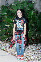"Alexandra Camargo, 21, of Miami, poses for a portrait wearing an Obama Hope t-shirt outside a campaign rally for Democratic presidential nominee Hillary Clinton in the Theodore R. Gibson Health Center at Miami Dade College-Kendall Campus in Miami, Florida, USA. Former Vice President Al Gore also spoke at the rally. Camargo is a journalism student at Miami Dade College and said she supported Bernie Sanders during the primary. She now supports Hillary, but said, ""I have mixed feelings with it. [But] Hillary has Bernie's platform now. Anything to keep Trump out of office."""