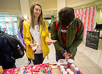 NWA Democrat-Gazette/JASON IVESTER<br /> Erika Hash of Springdale and her boyfriend Grant Thornton of Fayetteville decorate cookies Tuesday, Feb. 14, 2017, in the student center at Northwest Arkansas Community College in Bentonville. The Student Ambassador and Activities Board hosted the free Valentine's Day event which offered cookies for decorating and a photo booth.