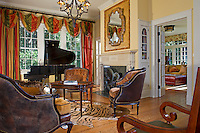 """This """"Wild Kingdom"""" inspired living room combines animal prints with classic stripes and paisley."""
