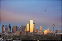 From east of downtown, you can gain a great view of the Dallas Skyline. On the March evening I shot this image of the Dallas cityscape, the flight pattern into Love Field was just above the city. I timed it right and captured this Southwest Airlines jet coming in for a landing over the highrises of Dallas. The sky had turned a nice shade of pastel pinks and blues, and the setting sun was beginning to light up the buildings, including the Bank of  America Plaza...To the far left is the iconic Reunion Tower whose lights had just turned on in anticipation of nightfall.