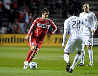 Chicago midfielder Gaston Puereri (18) looks for a way past Vancouver midfielder Gershon Koffie (28).  The Chicago Fire tied the Vancouver Whitecaps 0-0 at Toyota Park in Bridgeview, IL on May 7, 2011.