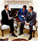 United States President Ronald Reagan, left, meets with Socialist Party Leader Mario Soares of Portugal, right, in the Oval Office of the White House in Washington, D.C. on Wednesday, February 23, 1983.  The woman in the center is unidentified..Mandatory Credit: Michael Evans - White House via CNP