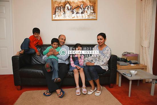 Asian family on sofa.