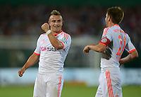 FUSSBALL  DFB POKAL       SAISON 2012/2013 Jahn Regensburg - FC Bayern Muenchen  20.08.2012 Jubel nach dem Tor zum 0:2 Xherdan Shaqiri mit Philipp Lahm (v. li., FC Bayern Muenchen)