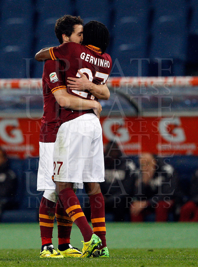 Calcio, Serie A: Roma vs Torino. Roma, stadio Olimpico, 25 marzo 2014.<br /> AS Roma forward Mattia Destro celebrates with teammate Gervinho, of Ivory Coast, right, after scoring during the Italian Serie A football match between AS Roma and Torino at Rome's Olympic stadium, 25 March 2014.<br /> UPDATE IMAGES PRESS/Riccardo De Luca