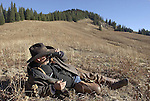 Hunting guide Dick Smith scans the Gros Ventre Wilderness while taking a break on a ridge line near Spike Camp.