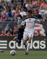 Philadelphia Union forward Sebastien Le Toux (9) on the attack. In a Major League Soccer (MLS) match, the Philadelphia Union defeated the New England Revolution, 3-0, at Gillette Stadium on July 17, 2011.