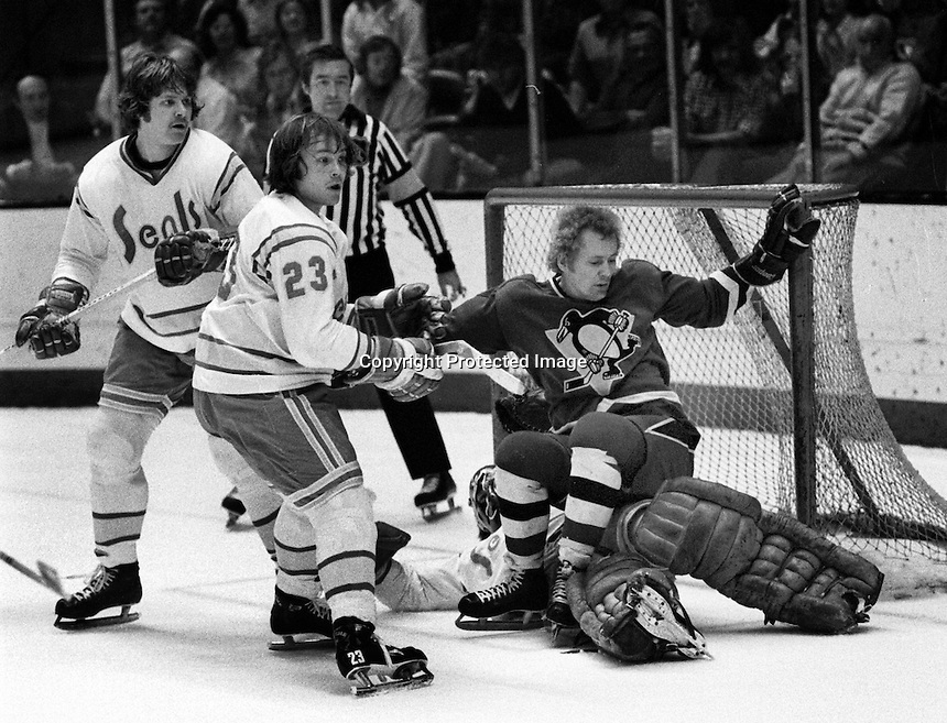Pittsburg's Eddie Gilbert falls down on Seal goalie Gary Simmons as Tim Jacobs and Len Frig follow the puck. (photo/Ron Riesterer)