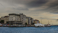 Fine Art Print Photograph. The Bosphorus Strait in Istanbul, Turkey. The dramatic lighting on the buildings and the birds flying overhead create the mood of this print. <br />