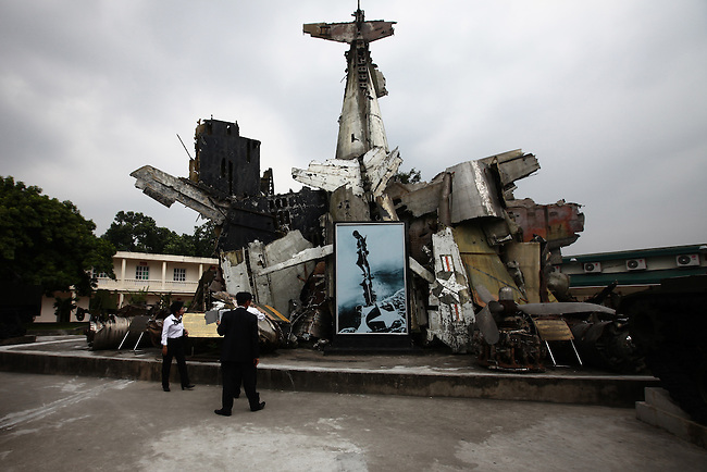 Visitors examine a sculpture made from pieces of U.S. aircraft shot down during the Vietnam War at the Viet Nam Military History Museum in Hanoi, Vietnam. Oct. 27, 2012.