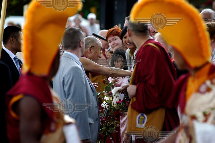 His Holiness the Dalai Lama meets members of the public at the Vajradhara Ling Buddhist Temple during the visit of His Holiness to France. The Dalai Lama blessed a project to build a Temple for Peace at the centre and gave a speech to hundreds of guests.