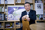 Eiju Hangai, president of Fukushia Recovery Solar, sits in his offices on Tokyo, Japan on 14 Feb. 2013.  A former employee of Tepco, the utilities company that runs the damaged Fukushima Daiichi Nuclear power Plant, Hangai established the Minamisoma Agri-Solar Park in Minamisoma, Fukushima, just 25 km from the Daiichi plant. More than 2,000 solar panels will power greenhouse domes, inside which farmers affected by the 2011 tsunami and nuclear accident will be able to grow produce.  .Photographer: Robert Gilhooly