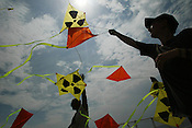 KITES BY LUTZ TRECZOCKS, YELLOW &quot;STOP PLUTONIUM&quot; KITE, JAPAN. 030702. .PIC &copy; JEREMY SUTTON-HIBBERT/GREENPEACE 2002..*****ALL RIGHTS RESERVED. RIGHTS FOR ONWARD TRANSMISSION OF ANY IMAGE OR FILE IS NOT GRANTED OR IMPLIED. CHANGING COPYRIGHT INFORMATION IS ILLEGAL AS SPECIFIED IN THE COPYRIGHT, DESIGN AND PATENTS ACT 1988. THE ARTIST HAS ASSERTED HIS MORAL RIGHTS. *******