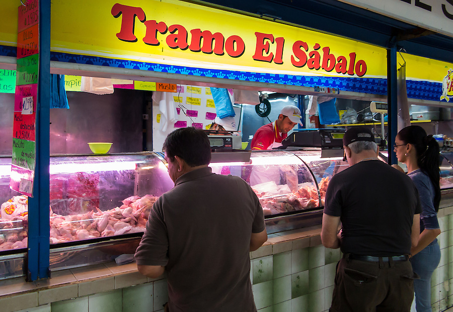 SAN JOSE, COSTA RICA - CIRCA AUGUST 2012: Merchant in the Central Market circa 2012 in San Jose, a very popular attraction and the biggest market in the city  with more than 10.000 daily visitors.