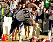 New England Patriots tight end Rob Gronkowski (87) struggles to keep his balance and on his feet as he eludes Washington Redskin cornerback Josh Wilson (26) as he carries for a 49 yard gain in the first quarter at FedEx Field in Landover, Maryland on Sunday December 11, 2011..Credit: Ron Sachs / CNP.(RESTRICTION: NO New York or New Jersey Newspapers or newspapers within a 75 mile radius of New York City)