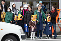 March 11, 2011, Tokyo, Japan - Nursery staff members in hard hats take youngsters all wearing yellow hoods to an evacuation site in Tokyo's Ikebukuro area following a severe earthquake that struck Japan's northeastern prefectures on Friday, March 11, 2011. Hundreds of people are feared dead after the country's biggest earthquake with a magnitude of 8.9 since records began struck the northeastern coasts, unleashing a 10-metre tsunami that swept away buildings, ships and vehicles. (Photo by AFLO) [3609] -mis-